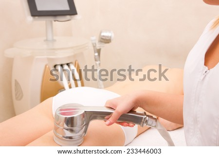 Woman getting light pulsed hair removal treatment - stock photo