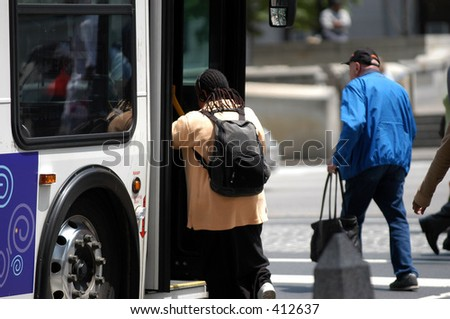 Woman getting on the bus - stock photo