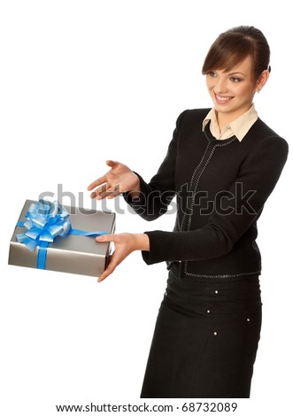 Woman giving a silver box with blue bow as a gift - stock photo