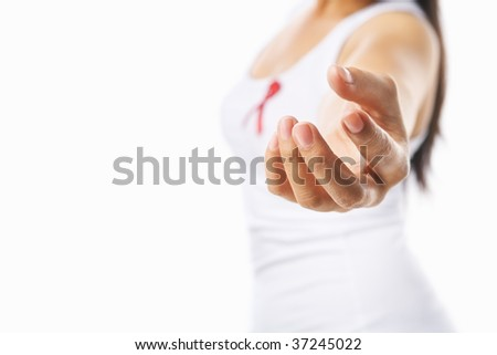 Woman giving her hand to give support for AIDS cause, using red ribbon badge on her chest. PS: you can change the ribbon color to pink for breast cancer support cause as both using the same symbol - stock photo