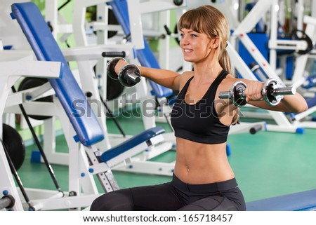 woman goes in for sports in sport hall - stock photo