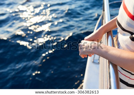 Woman going for a ride on a yacht.  - stock photo