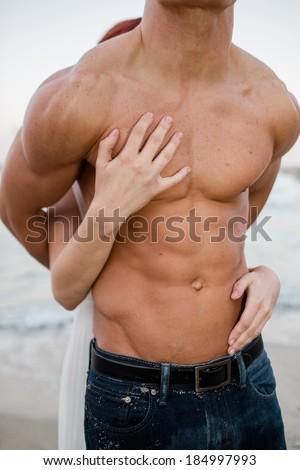 Woman Grabbing at Man - stock photo
