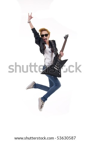 woman guitarist jumps making rock sign over white - stock photo