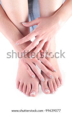 Woman hand and feet isolated on white - stock photo