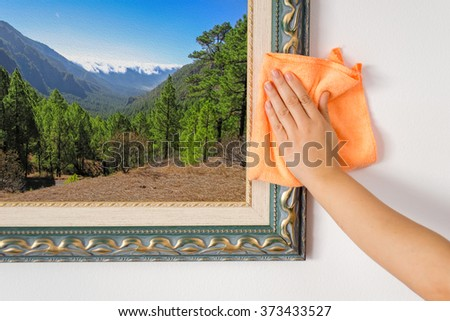 woman hand cleaning a ornate antique.Background pinture are my property - stock photo
