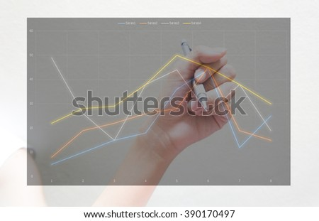 Woman Hand drawing graph business - stock photo