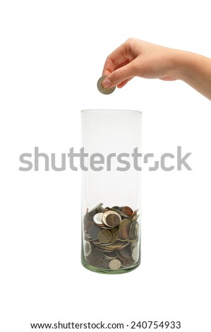 woman hand dropping coin into glass jar - stock photo