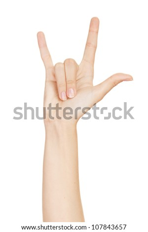 woman hand giving the devil horns gesture (isolated on white background) - stock photo