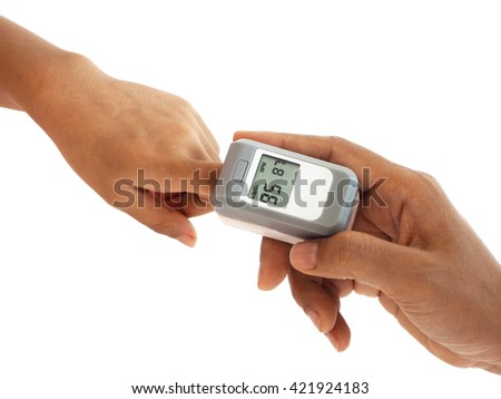 woman hand hold pulse oximeter for child used to measure pulse rate and oxygen levels , Patient with pulse oximeter on finger for monitoring - stock photo