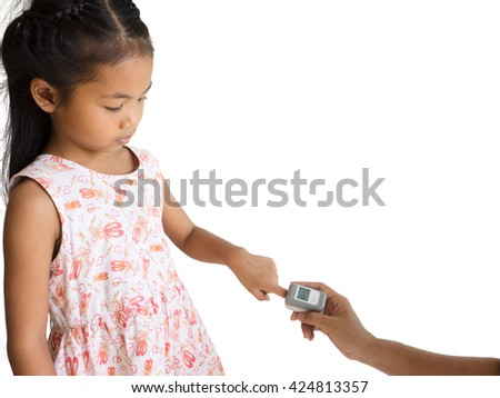 woman hand hold pulse oximeter for little asia girl used to measure pulse rate and oxygen levels , Patient with pulse oximeter on finger for monitoring - stock photo