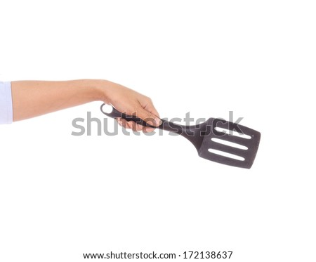 woman hand holding a kitchen spatula isolated on white background - stock photo
