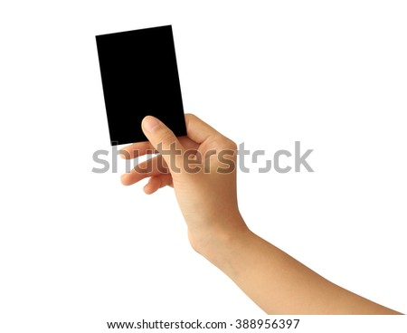 Woman hand holding blank black paper card isolated on white background - stock photo