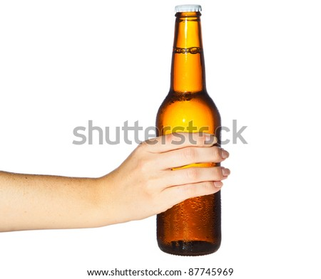 Woman hand holding bottle of beer - stock photo