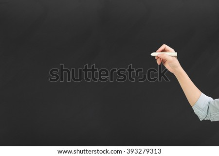 Woman hand holding chalk writing, side view, on black background. - stock photo