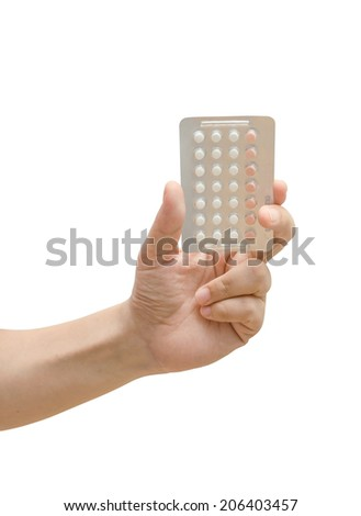 Woman hand holding contraceptives over white background - stock photo