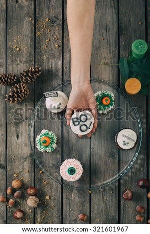 Woman hand holding cupcake. Selective focus and small depth of field. - stock photo
