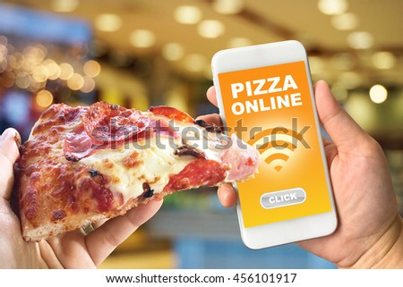 Woman hand holding smartphone against blur colorful bokeh background pizza online concept - stock photo
