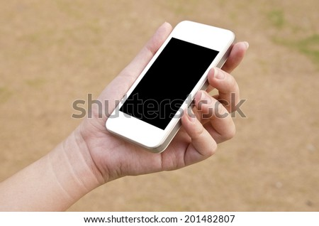 woman hand holding the phone tablet  - stock photo