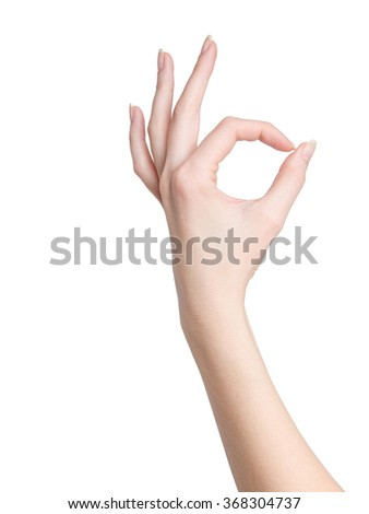 Woman hand in ok sign on a white isolated background - stock photo