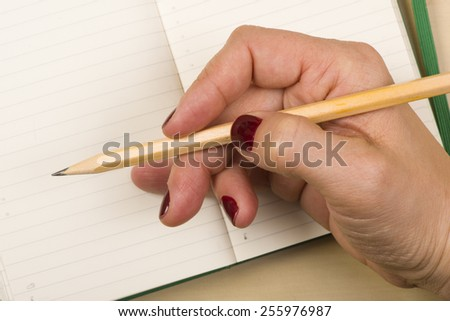 Woman hand notebook with pencil  details draw - stock photo