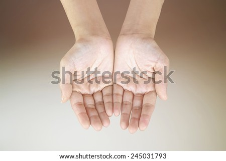 Woman hand on brown background - stock photo