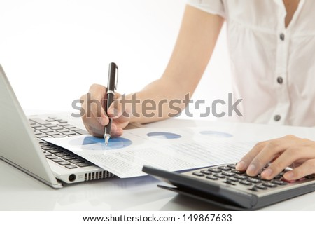 woman hand on laptop with business report - stock photo
