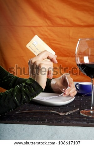 woman hand paying with credit card at restaurant - stock photo