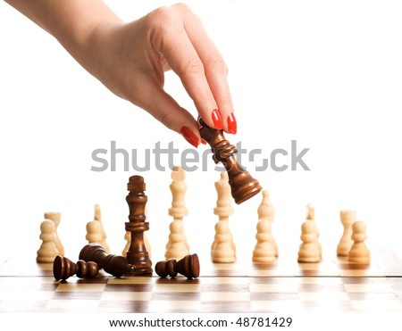 Woman hand playing chess - isolated - stock photo