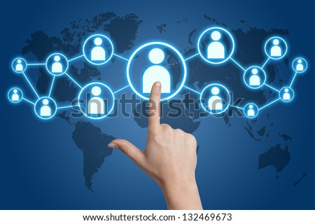 woman hand pressing social media icon on blue background with world map - stock photo