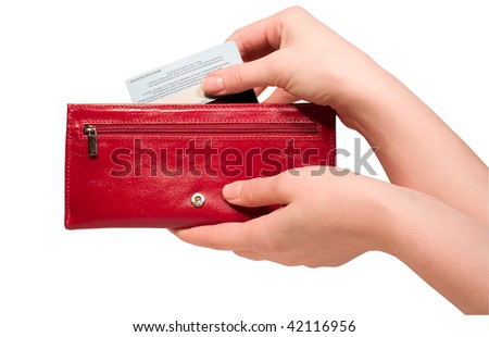 Woman hand pulling credit card out of a red purse -isolated over white background - stock photo