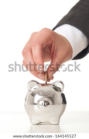 Woman hand saving money for the future. - stock photo