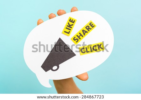 "Woman hand showing speech bubble with megaphone and the words ""LIKE"" ""SHARE"" ""CLICK"", on blue background. Social media and internet concept. - stock photo"