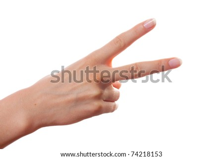 Woman hand shows victory gesture on white background - stock photo