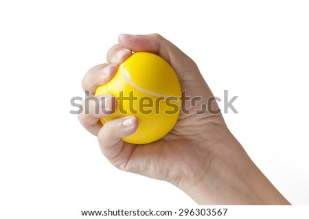 Woman hand squeezing a stress ball - stock photo