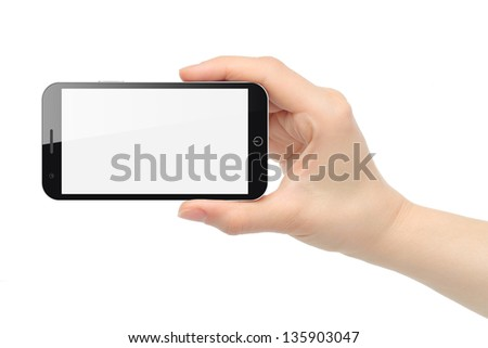 Woman hand uses touch screen interface with food on white background - stock photo
