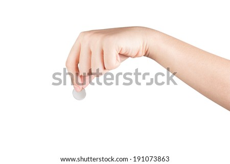 Woman hand with coin isolated on white background. - stock photo