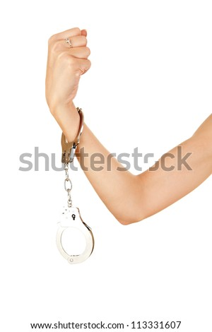 woman hand with handcuffs on the white background - stock photo