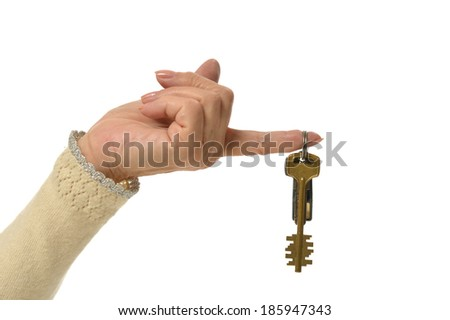 Woman hand with keys isolated on white - stock photo