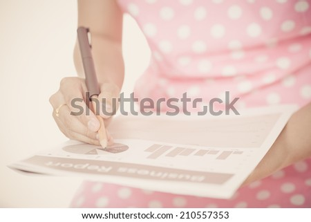 woman hand with pen and business report - stock photo
