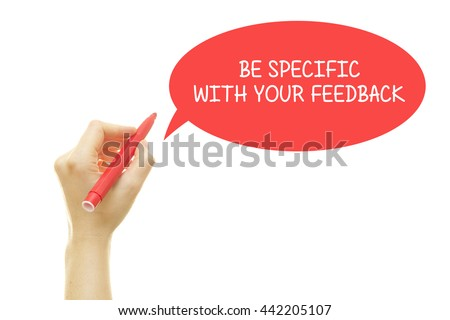 Woman hand writing BE SPECIFIC WITH YOUR FEEDBACK message with a marker isolated on white. - stock photo