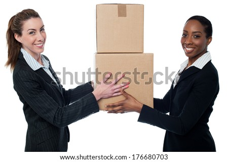 Woman handing over cardboard boxes - stock photo
