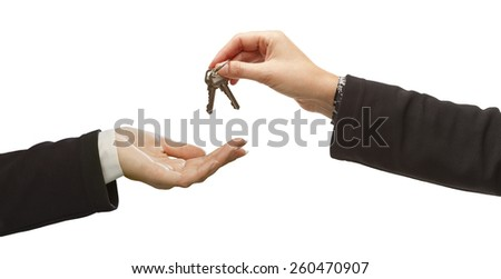 Woman Handing Over Woman Set Of Keys Isolated on White. - stock photo