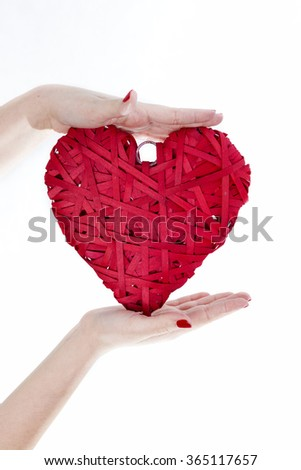 Woman Hands Hold Big Red Wicker Heart. Sign Of Love On White Background. Love Concept. - stock photo