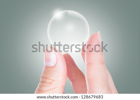 Woman hands hold empty bubble - stock photo