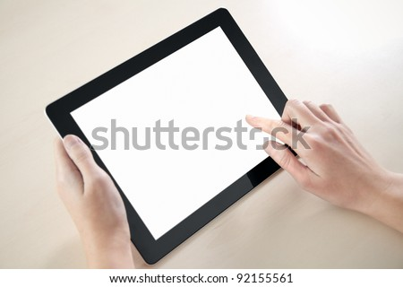 Woman hands holding and pointing on contemporary digital frame with blank screen. - stock photo