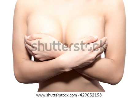 Woman hands holding breast - stock photo