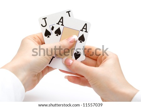 woman hands holding cards with 21 combination - ace and jack spades - blackjack - stock photo