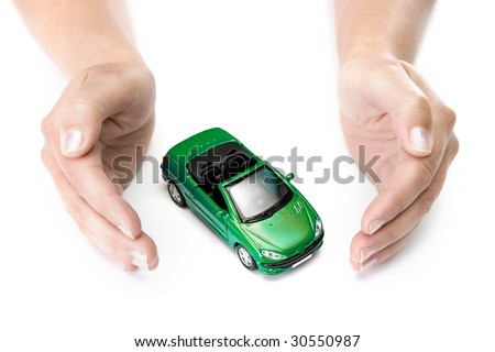 woman hands holding green car isolated on white background - stock photo