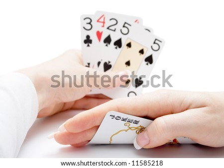 woman hands holding playing cards with poker straight combination and a joker being drawn - stock photo